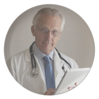 Portrait of a medical doctor holding a digital party plate