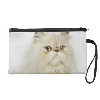 Portrait of a Persian cat Wristlet Purses