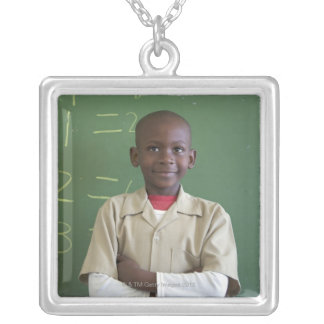 Portrait of a schoolboy at the classroom silver plated necklace