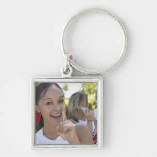 Portrait of a Teenage Cheerleader Holding a Silver-Colored Square Key Ring