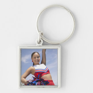 Portrait of a Teenage Cheerleader Holding Silver-Colored Square Key Ring