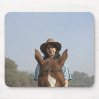 Portrait of a teenage girl riding a horse mousepad