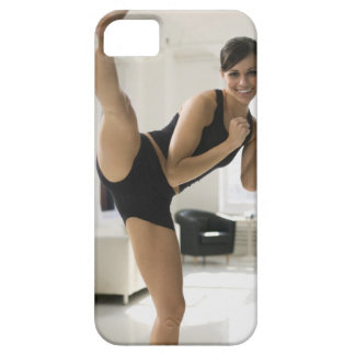 Portrait of a woman kicking iPhone 5 cover