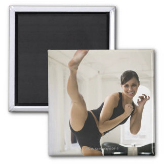 Portrait of a woman kicking magnet