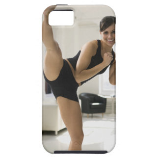 Portrait of a woman kicking tough iPhone 5 case
