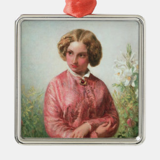 Portrait of a young girl with a rose christmas ornament