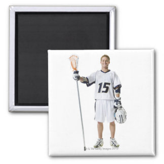 Portrait of a young man holding a lacrosse stick magnet