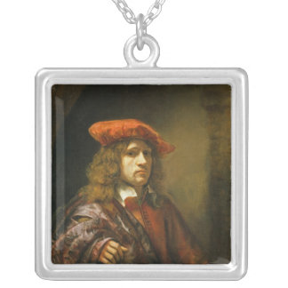 Portrait of a young man in a red cap silver plated necklace