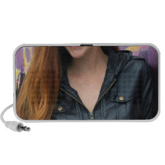 Portrait of a young woman mini speakers