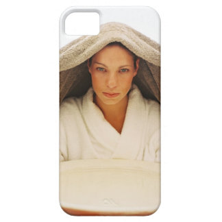 portrait of a young woman with a towel over her case for the iPhone 5