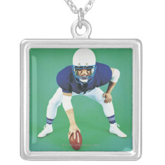 Portrait of An American Football Player Holding Silver Plated Necklace