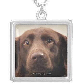 Portrait of an apprehensive young female square pendant necklace