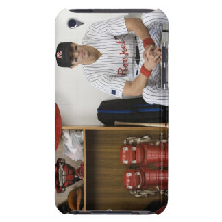 Portrait of baseball player sitting in locker iPod touch cases