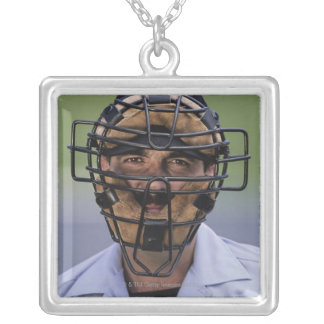 Portrait of baseball umpire wearing protective necklaces