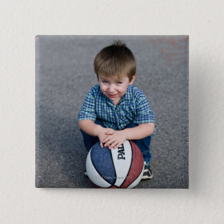 Portrait of boy with basketball outdoors 15 cm square badge