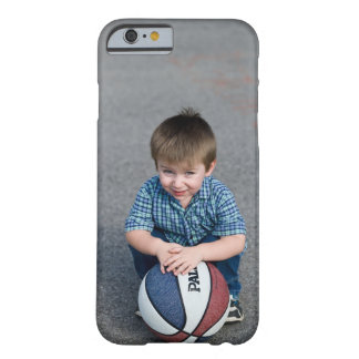 Portrait of boy with basketball outdoors barely there iPhone 6 case