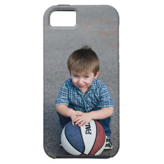 Portrait of boy with basketball outdoors iPhone 5 case