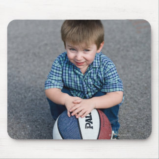 Portrait of boy with basketball outdoors mouse mat