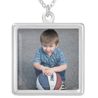 Portrait of boy with basketball outdoors square pendant necklace