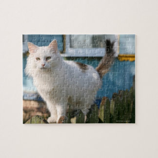 Portrait of cat on fence jigsaw puzzle