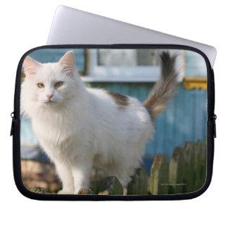 Portrait of cat on fence laptop sleeve