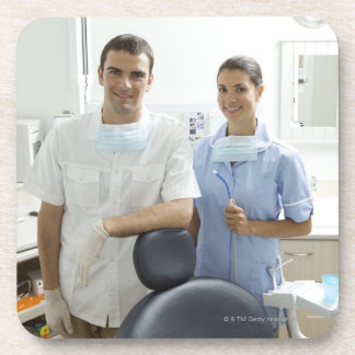 Portrait of dentist and his assistant in a coasters