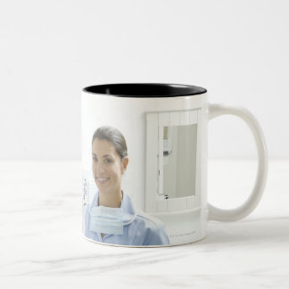 Portrait of dentist and his assistant in a Two-Tone mug