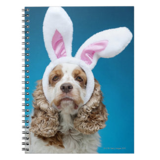 Portrait of dog wearing Easter bunny ears Notebooks