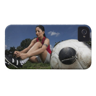 portrait of female football player tying her iPhone 4 case