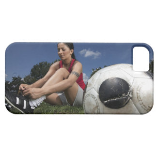 portrait of female football player tying her iPhone 5 cover