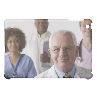 Portrait of four medical professionals, studio cover for the iPad mini