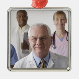 Portrait of four medical professionals, studio Silver-Colored square decoration