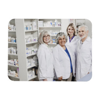 Portrait of four smiling pharmacists magnet