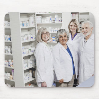 Portrait of four smiling pharmacists mouse pad