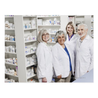 Portrait of four smiling pharmacists postcard