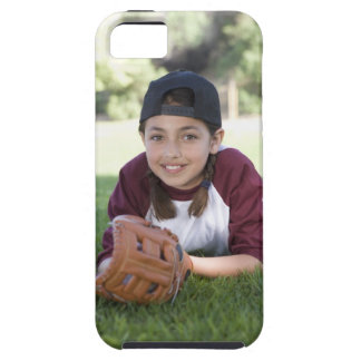 Portrait of girl lying on ground with baseball case for the iPhone 5