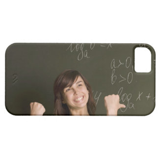 portrait of happy female student in front of iPhone 5 cases