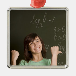 portrait of happy female student in front of Silver-Colored square decoration