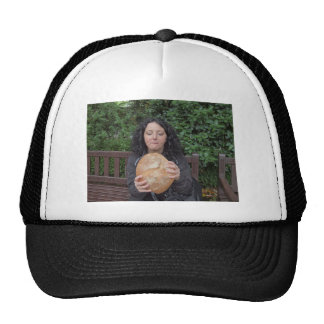 Portrait of hungry pretty young brunette eating hat