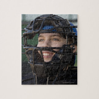 Portrait of little league catcher in mask puzzles