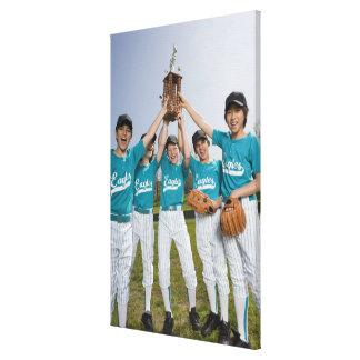 Portrait of little league players with trophy canvas print