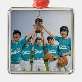 Portrait of little league players with trophy christmas ornament