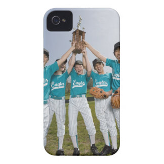 Portrait of little league players with trophy iPhone 4 cover