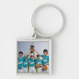 Portrait of little league players with trophy key ring