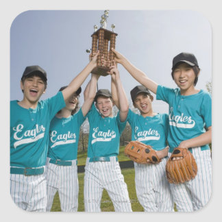 Portrait of little league players with trophy square sticker