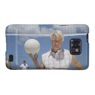 Portrait of mature man holding volley ball on galaxy s2 case