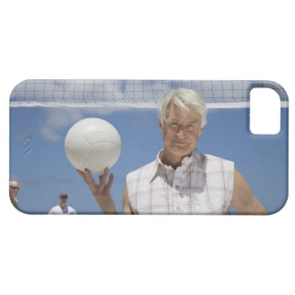 Portrait of mature man holding volley ball on case for the iPhone 5
