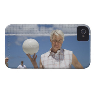 Portrait of mature man holding volley ball on iPhone 4 cases
