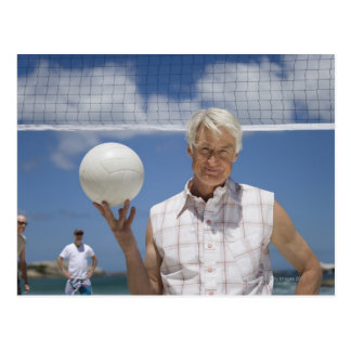 Portrait of mature man holding volley ball on postcard