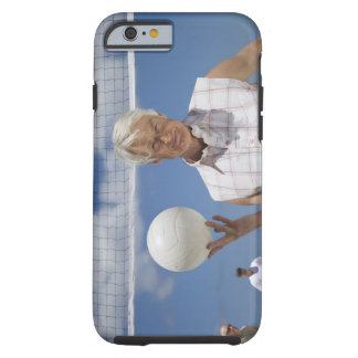 Portrait of mature man holding volley ball on tough iPhone 6 case